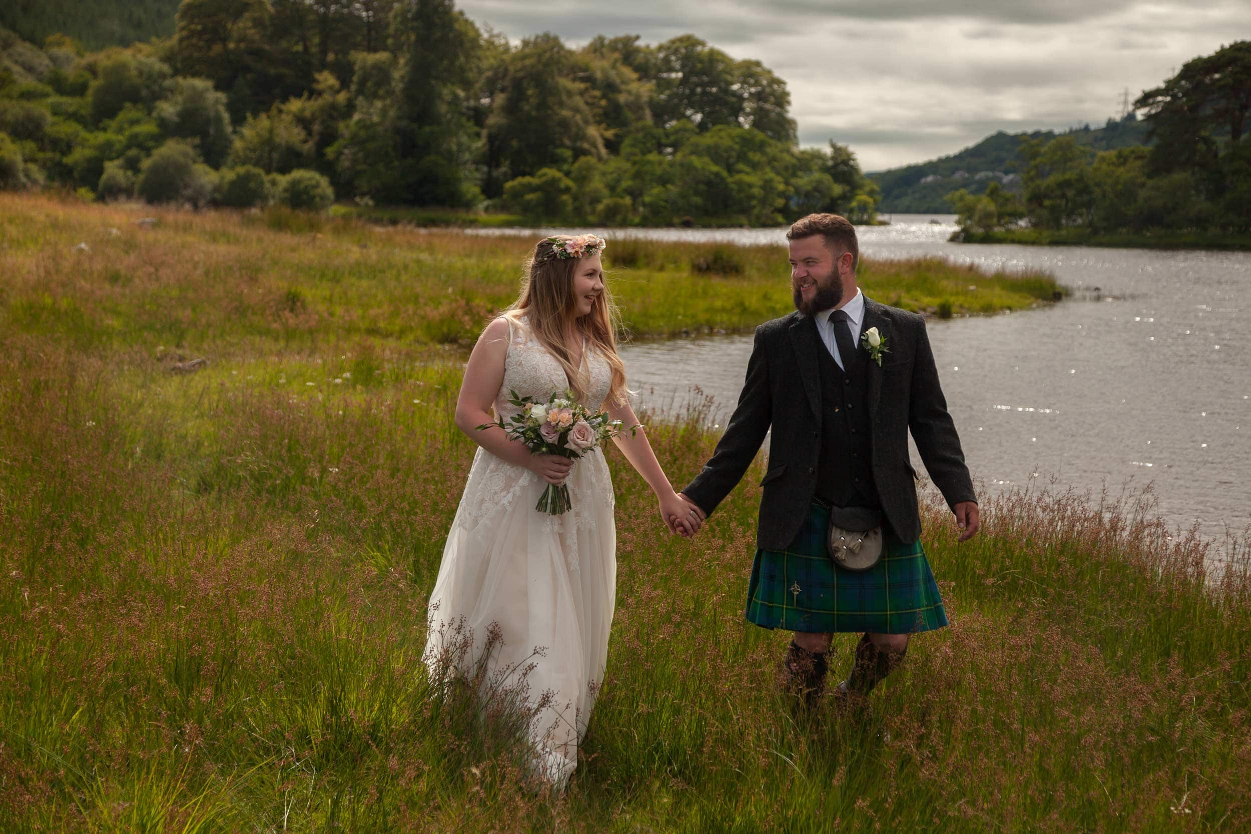 wedding photograph of bride & groom walking after their Argyll wedding